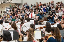 Marisa McCleod conducting young musicians for the BRAVO! concert at the Page Youth Center 4/29/17